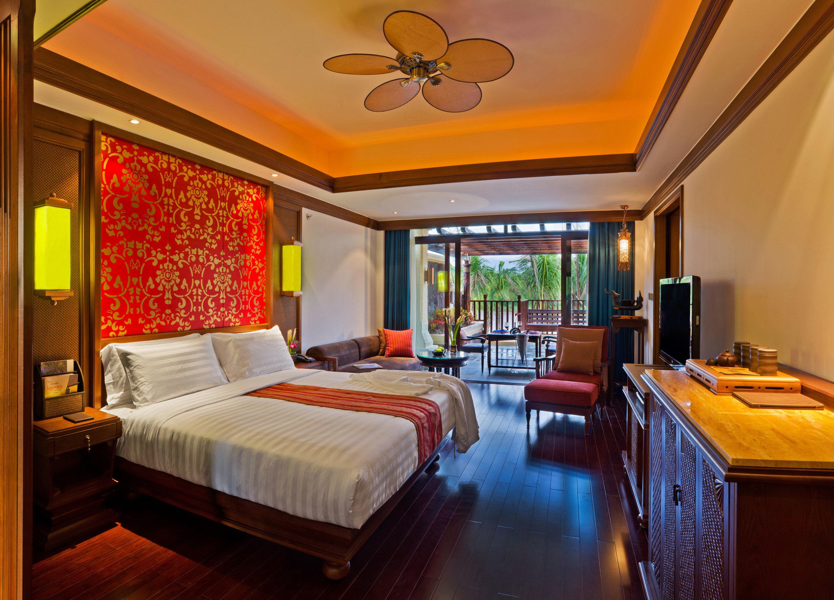 Balcony Bedroom Lounge Scenic views Suite property Resort home cottage living room Villa