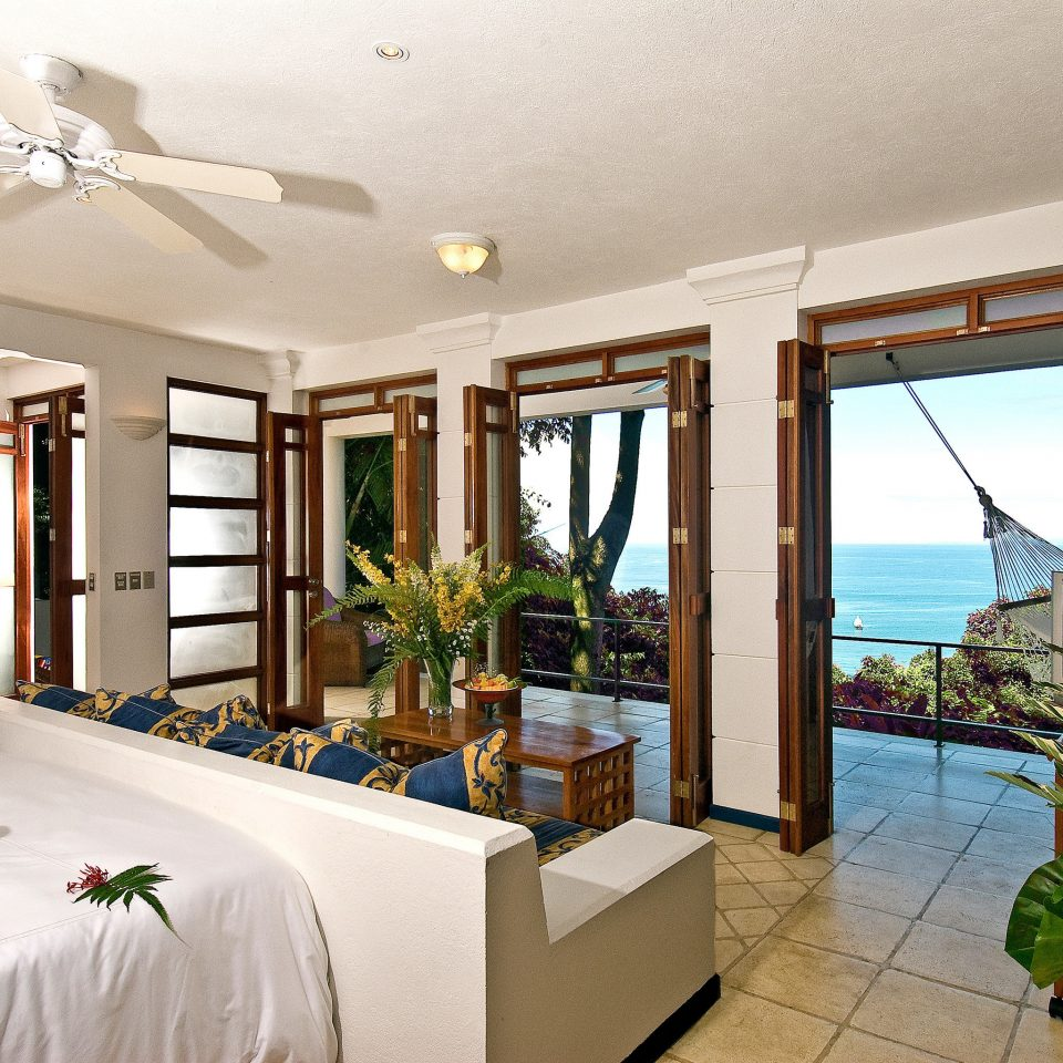 Balcony Bedroom Luxury Patio Scenic views Suite Tropical property Villa Resort house home condominium cottage mansion living room plant