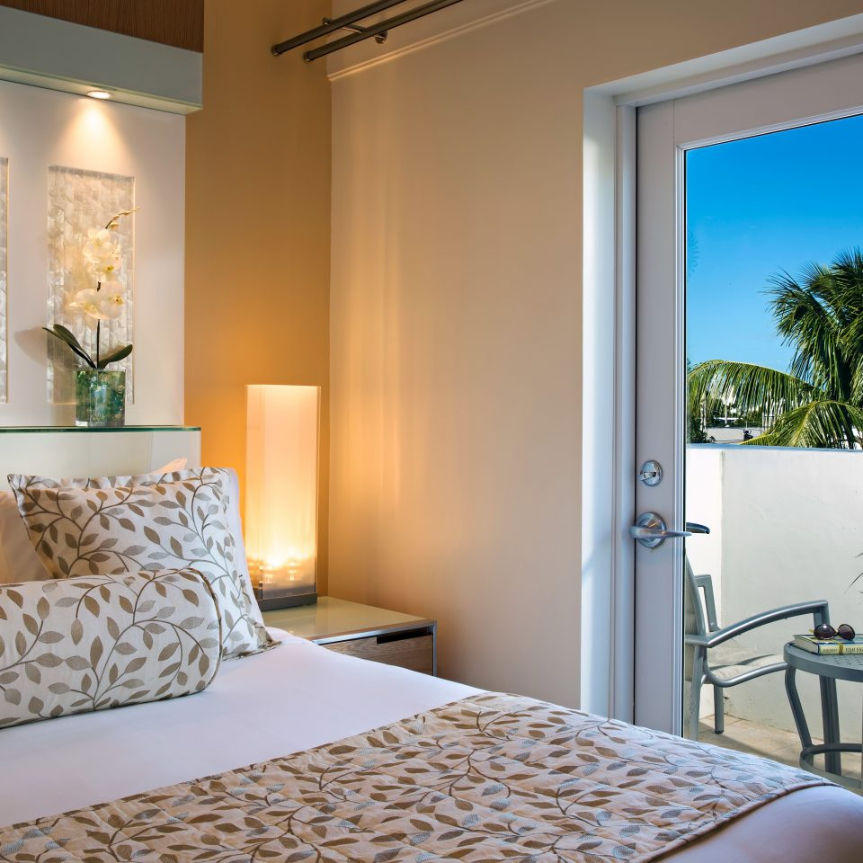Balcony Bedroom Modern Scenic views Suite property home condominium living room cottage containing