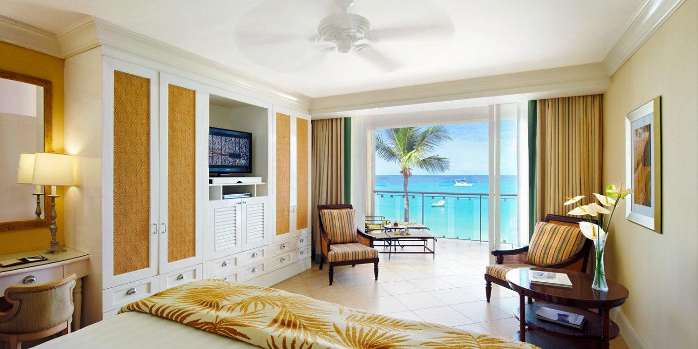 Balcony Bedroom Ocean Scenic views Suite property living room home cottage condominium hardwood Villa flat