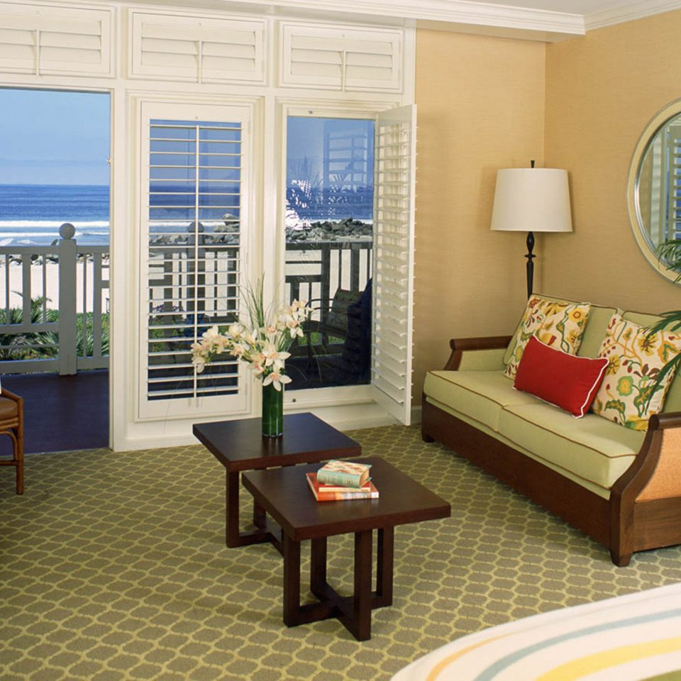 Balcony Bedroom Ocean Waterfront property living room home condominium hardwood cottage Suite Villa