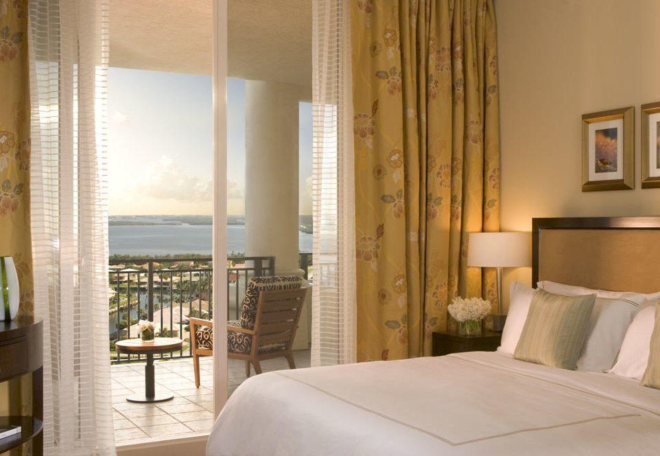 Balcony Bedroom Romance Romantic Tropical Waterfront property Suite condominium home curtain window treatment textile