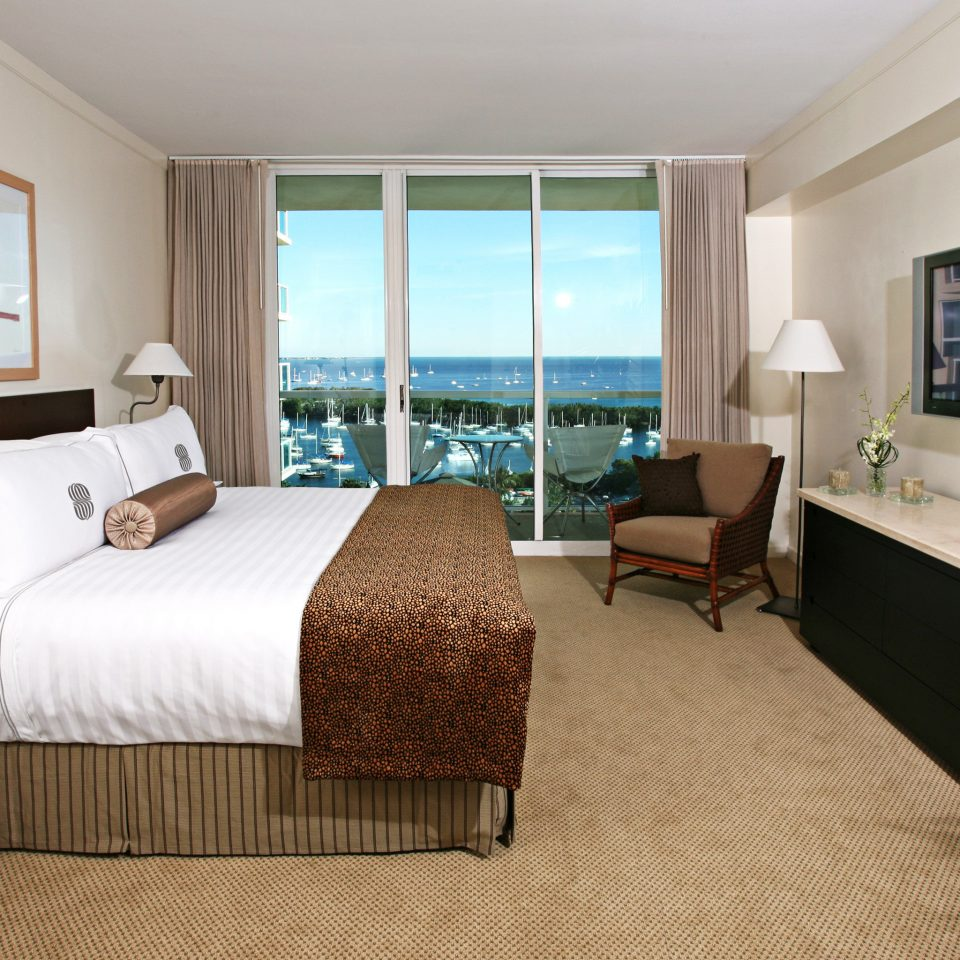 Balcony Bedroom Scenic views Waterfront sofa property Suite cottage living room flat home condominium containing