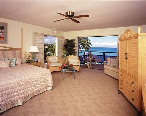 Balcony Bedroom Scenic views Suite Tropical property cottage Villa home hardwood living room night