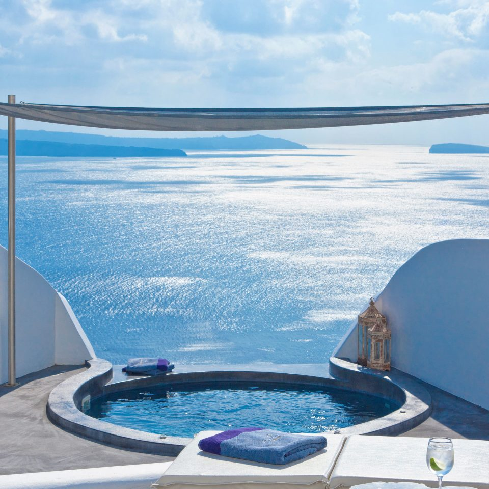 Balcony Classic Elegant Greece Hot tub/Jacuzzi Hotels Island Luxury Romantic Santorini Scenic views Suite Trip Ideas Waterfront sky water swimming pool yacht Boat vehicle Ocean overlooking passenger ship Sea jacuzzi Deck day