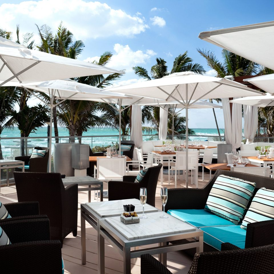 Balcony Dining Drink Eat Hotels Outdoors Patio Resort sky tree chair restaurant caribbean yacht vehicle Boat set Deck