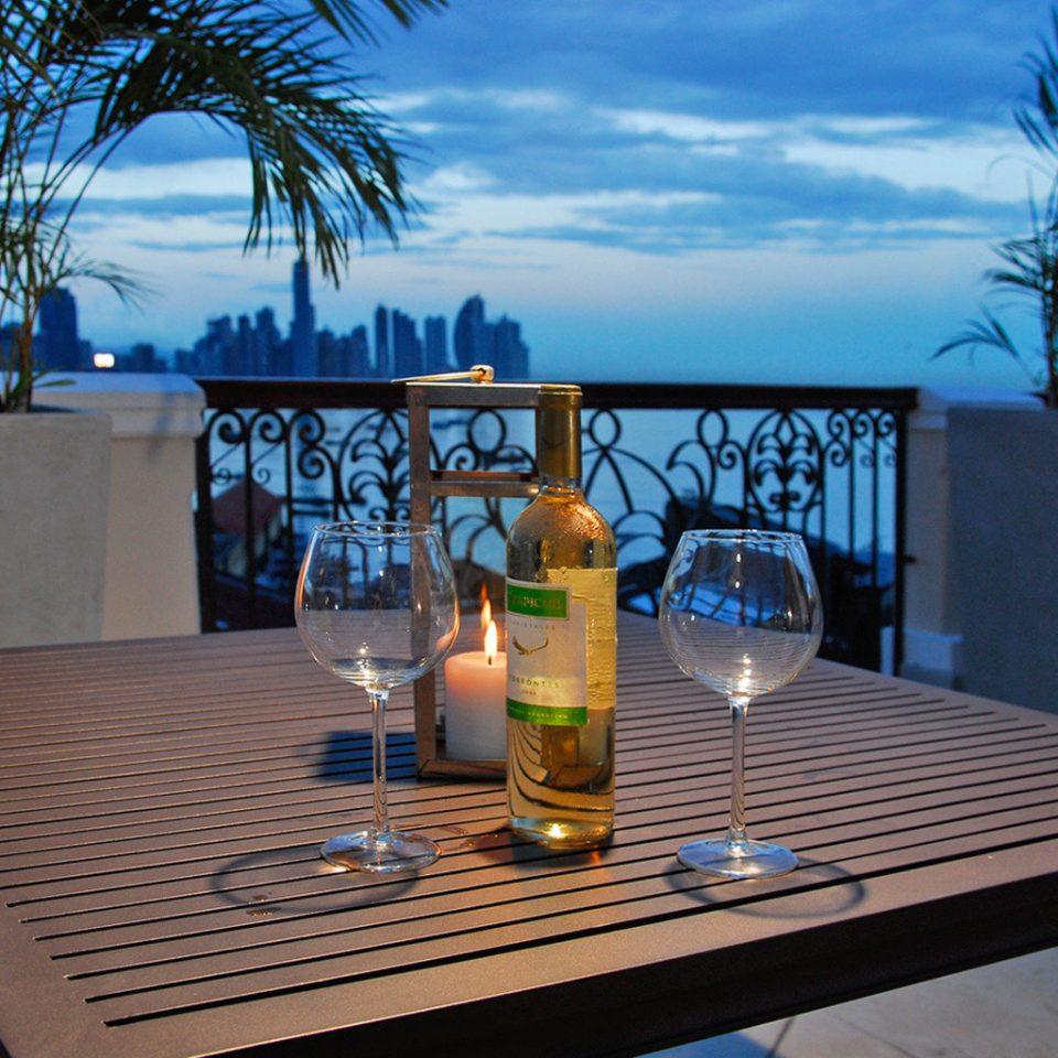Balcony Boutique Dining Drink Eat Nightlife Scenic views leisure swimming pool property glass Resort home Villa condominium backyard beer