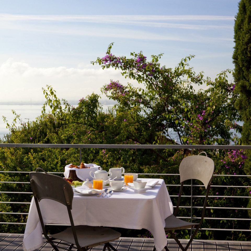 Balcony Boutique breakfast Dining Elegant food Food + Drink Garden Garden view Greenery Luxury outdoor dining park Patio private dining regal sophisticated Terrace view tree flower backyard home restaurant