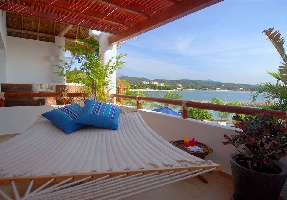 Balcony Budget Family Resort Tropical Villa Waterfront property swimming pool leisure caribbean hacienda plant eco hotel cottage