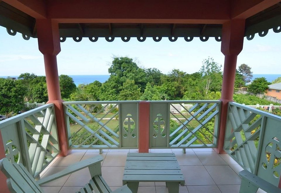Balcony Budget Ocean Patio Rustic Scenic views Tropical tree sky building property porch wooden Villa Resort outdoor structure home cottage shade