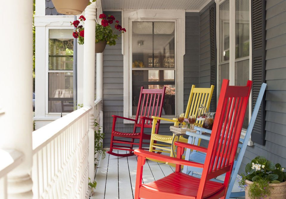 chair property porch home house cottage red living room outdoor structure Balcony