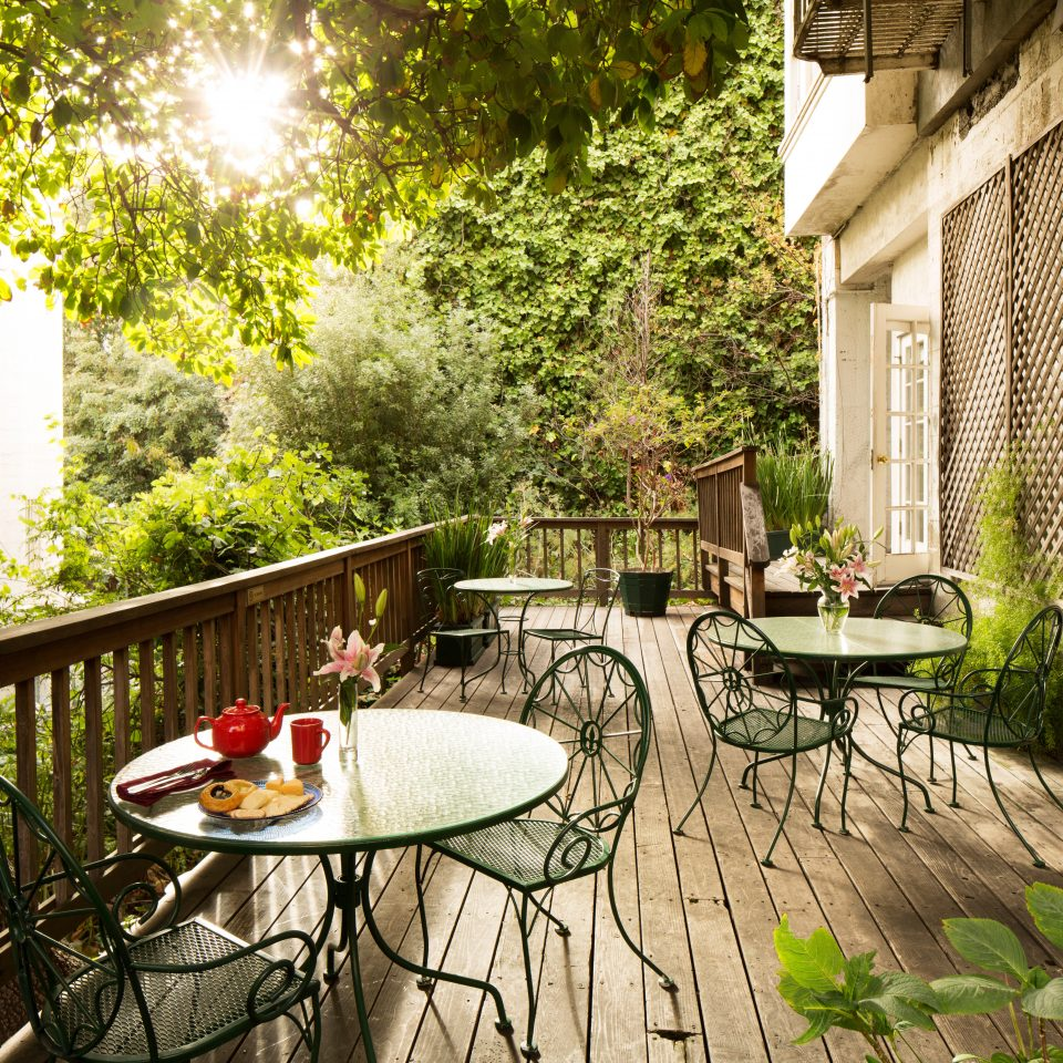Balcony City Dining Eat Outdoors Terrace tree property backyard building Courtyard house yard home porch cottage Garden Villa outdoor structure flower Patio stone