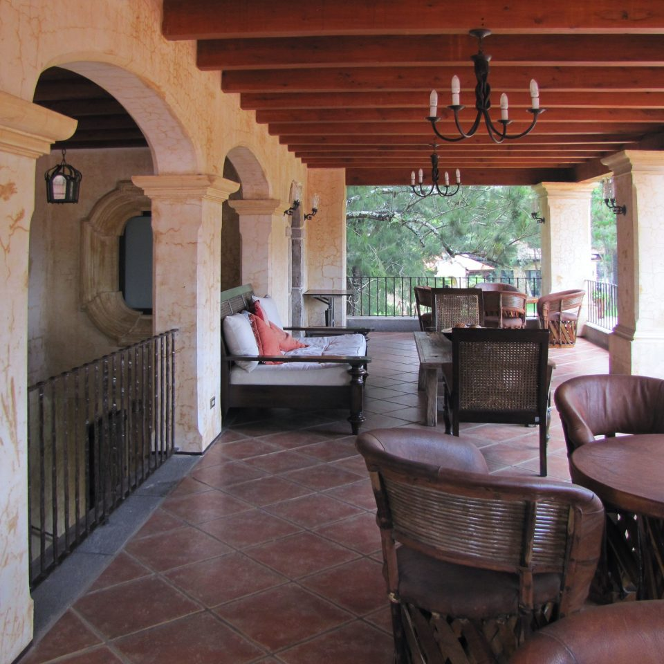 Balcony Classic Cultural Lounge Outdoors Rustic property house home cottage Villa living room hacienda porch farmhouse log cabin mansion