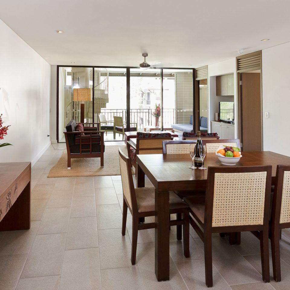 Balcony Classic Resort property home hardwood Dining condominium Suite Villa living room cottage dining table