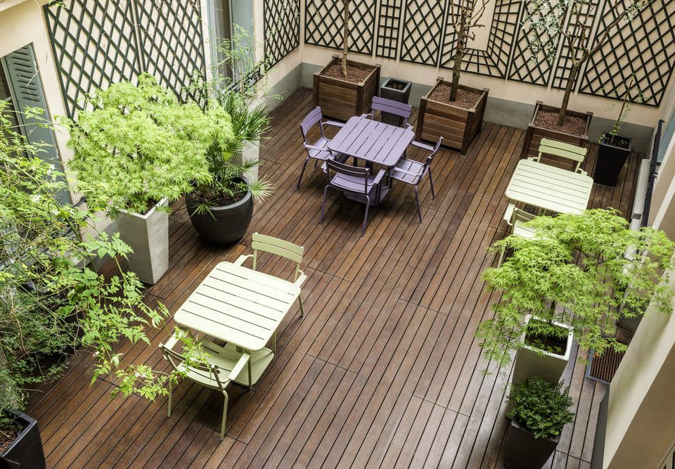 property wooden Balcony backyard Courtyard yard condominium Deck home Garden outdoor structure cottage landscape architect porch plant