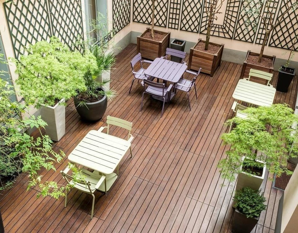 property Balcony backyard Deck Courtyard wooden yard outdoor structure Garden home condominium cottage landscape architect plant