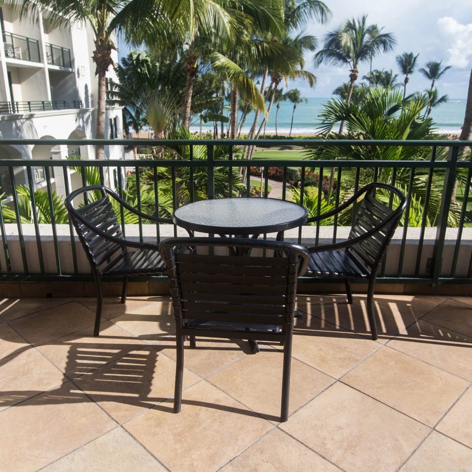 chair property building outdoor structure walkway backyard Patio Balcony Deck Courtyard Villa