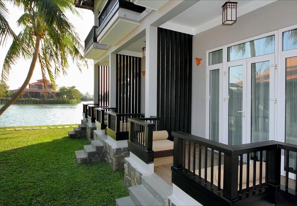building grass property condominium porch house home Villa Resort mansion cottage Courtyard outdoor structure Balcony Deck