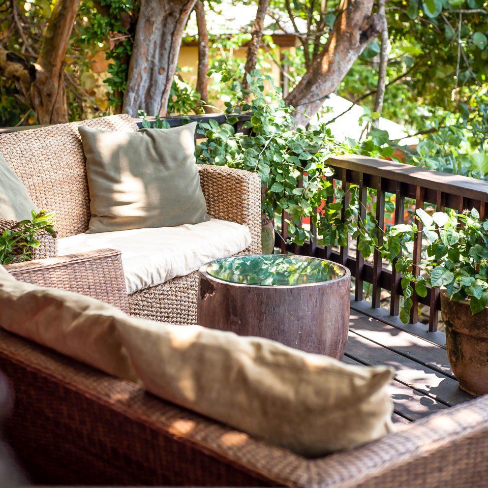 Balcony Eco Island Jungle Lounge Scenic views tree backyard Garden porch yard outdoor structure home cottage Courtyard flower Resort