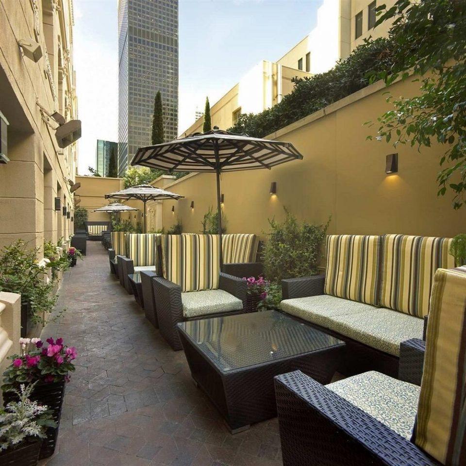 Courtyard Lounge Outdoors Patio Terrace property condominium outdoor structure backyard Villa Balcony lined Garden stone