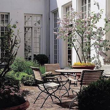 plant property chair Courtyard building porch home yard backyard outdoor structure Balcony Garden cottage Patio
