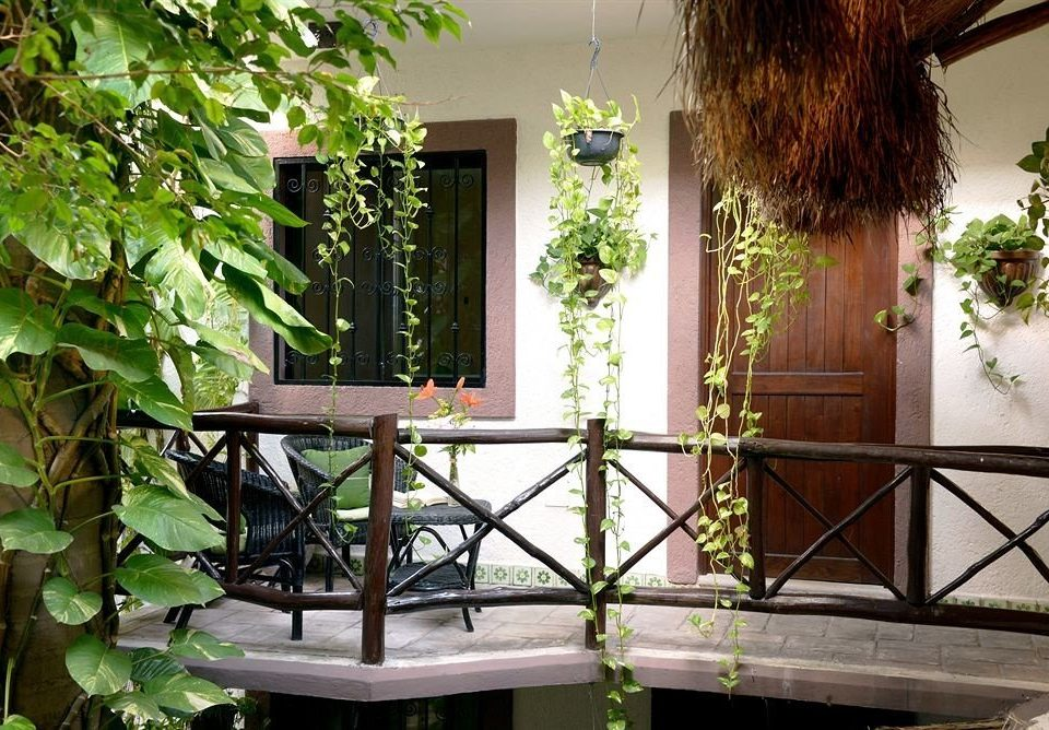 property house Balcony home Courtyard outdoor structure porch backyard cottage Garden yard flower Villa