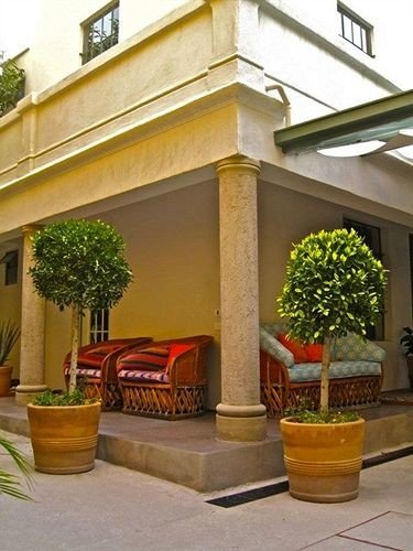 property porch home Courtyard Balcony hacienda outdoor structure Villa plant baluster arch stone
