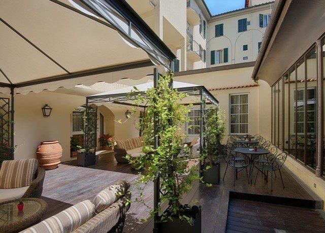 property house home porch Courtyard outdoor structure condominium cottage backyard Villa Balcony
