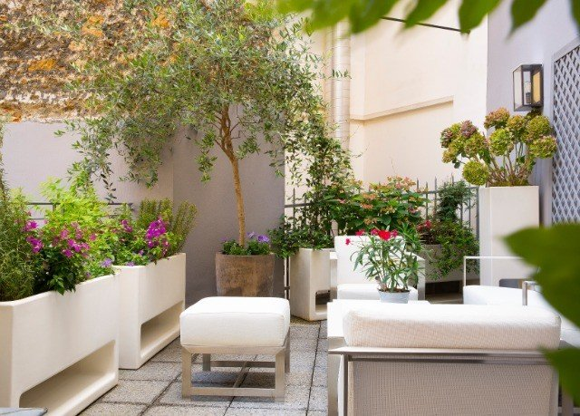 flower plant property Courtyard home condominium living room backyard cottage Balcony Villa outdoor structure