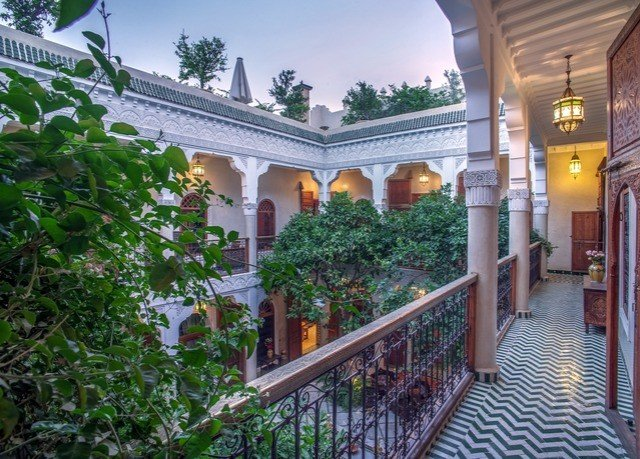 property building home Courtyard mansion house Villa hacienda outdoor structure Balcony roof