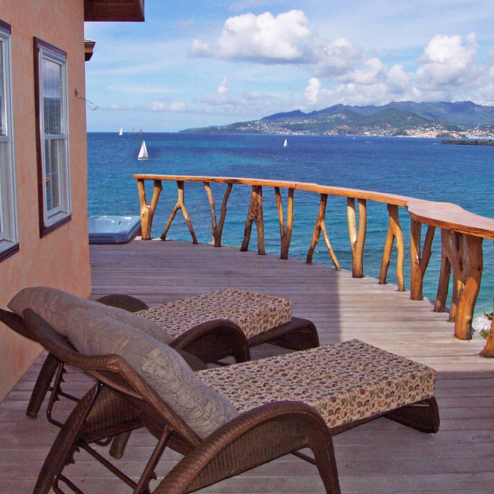 Balcony Cultural Eco Island Romance Scenic views Villa Waterfront water sky ground chair property leisure Resort Ocean cottage wooden caribbean