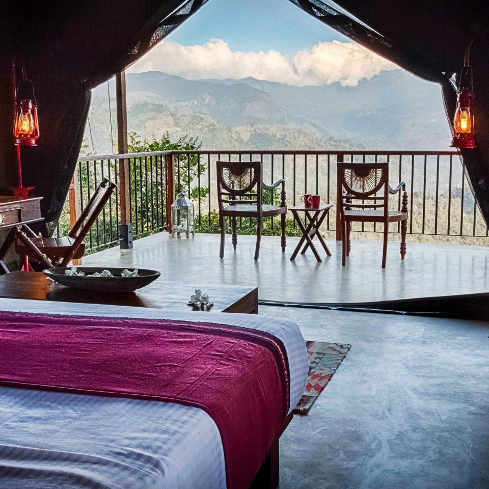 Balcony Cultural Honeymoon Luxury Outdoors Rustic Scenic views house restaurant Resort cottage Villa