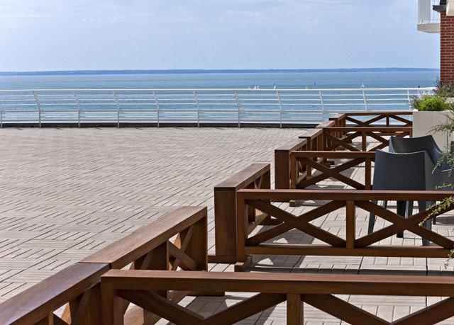sky chair walkway wooden property handrail outdoor structure Balcony roof boardwalk Deck cottage dock day