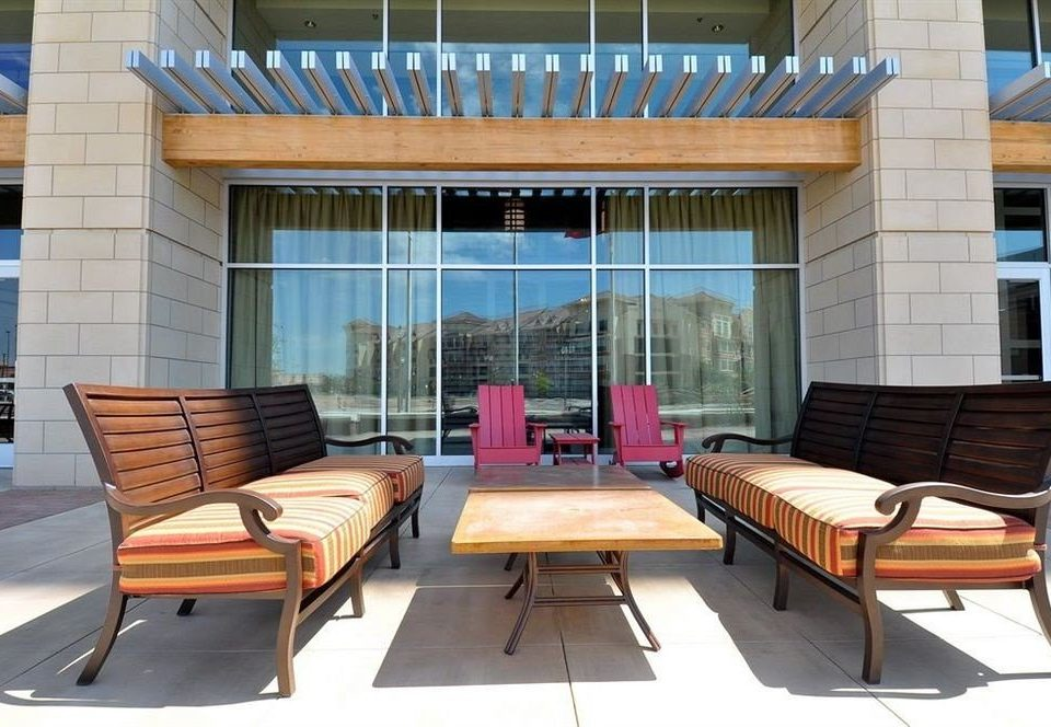 chair property wooden Deck outdoor structure living room home porch Balcony condominium dining table