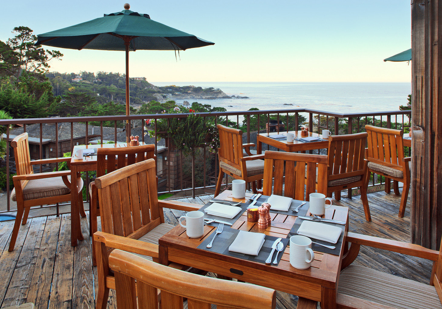 Balcony Deck Dining Drink Eat Ocean Patio Scenic views chair sky umbrella property wooden Resort restaurant lawn cottage vehicle Villa set