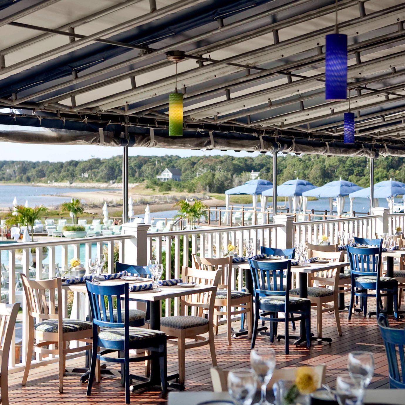 Balcony Deck Dining Drink Eat Food + Drink Hotels Lounge Luxury Travel Patio Resort Terrace Travel Deals Trip Ideas Weekend Getaways chair restaurant