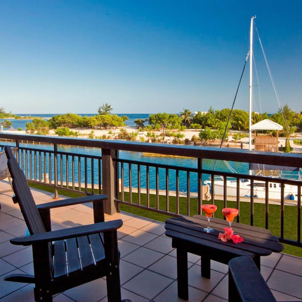 Balcony Eco Island Lounge Outdoor Activities Scenic views Waterfront sky leisure property Resort dock Villa overlooking Deck day