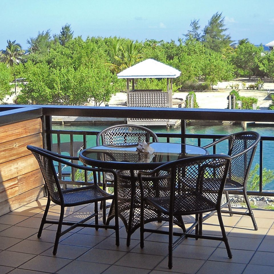 Balcony Eco Island Lounge Outdoor Activities Scenic views Waterfront sky ground property outdoor structure backyard Villa cottage swimming pool Patio home set Deck dining table