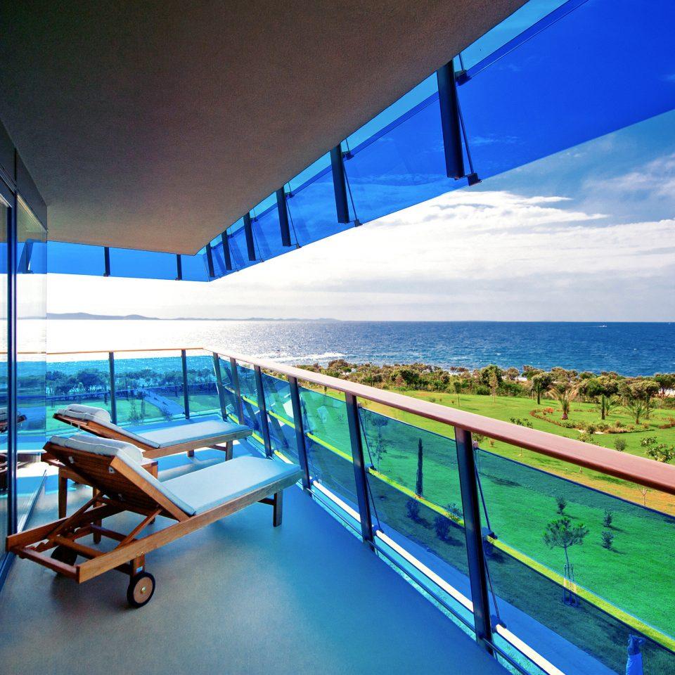 Balcony Grounds Lounge Modern Scenic views Waterfront leisure blue swimming pool property Ocean house Sea caribbean Resort condominium Villa Deck