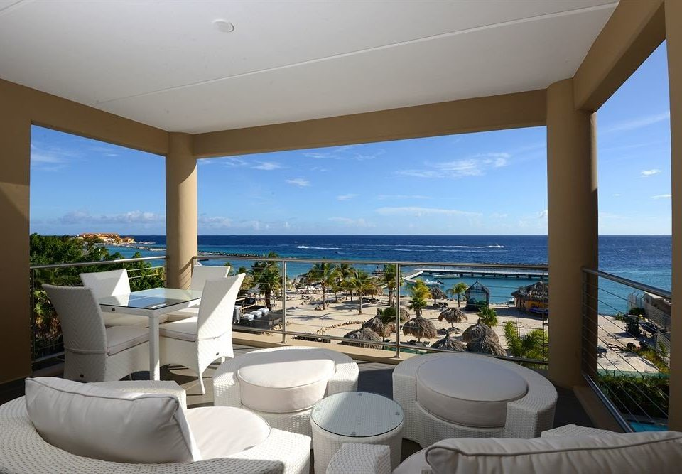 Balcony Hip Lounge Luxury Modern Scenic views property Ocean overlooking condominium Resort swimming pool Villa home living room caribbean white Suite mansion cottage beautiful Deck