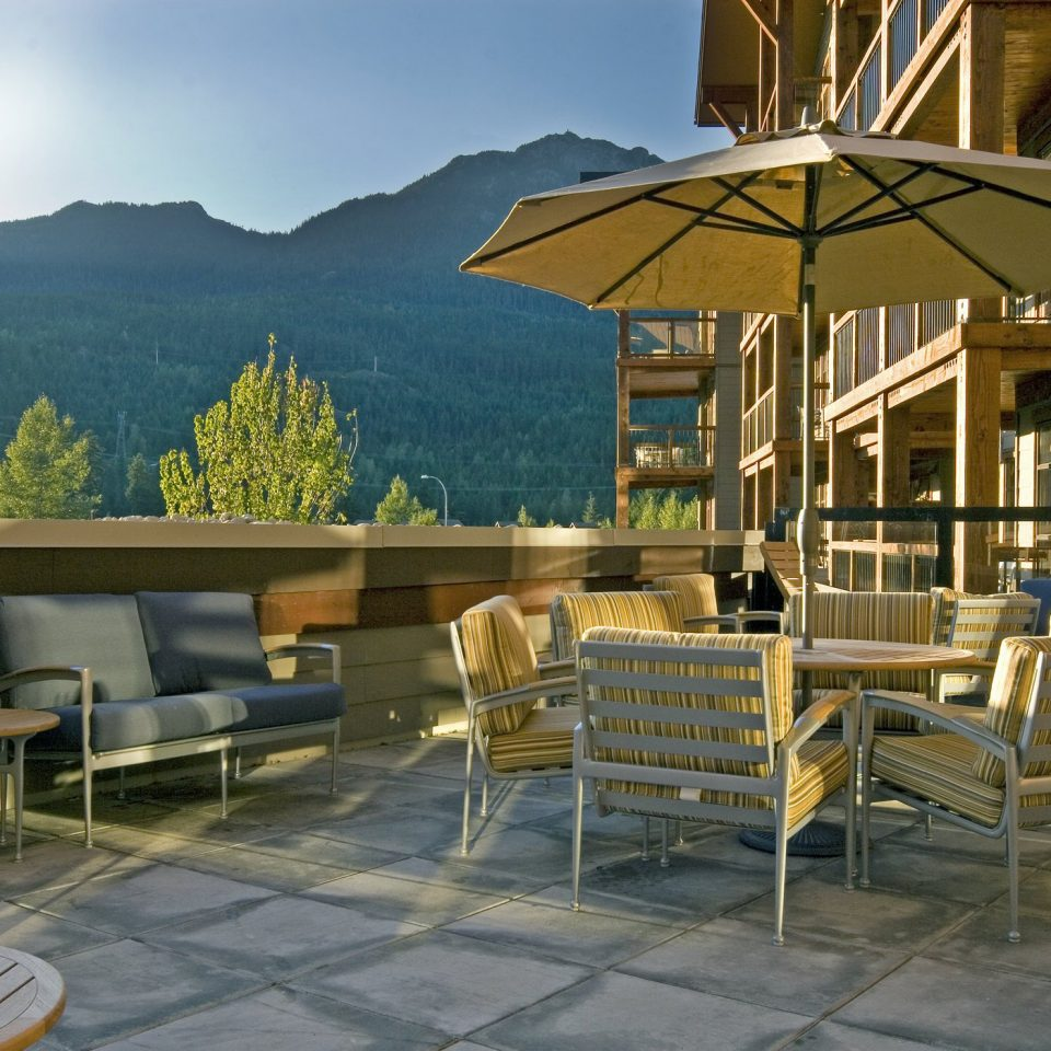 Balcony Deck Lodge Modern Mountains Outdoor Activities Scenic views Suite chair mountain property house Resort home cottage outdoor structure restaurant Villa overlooking