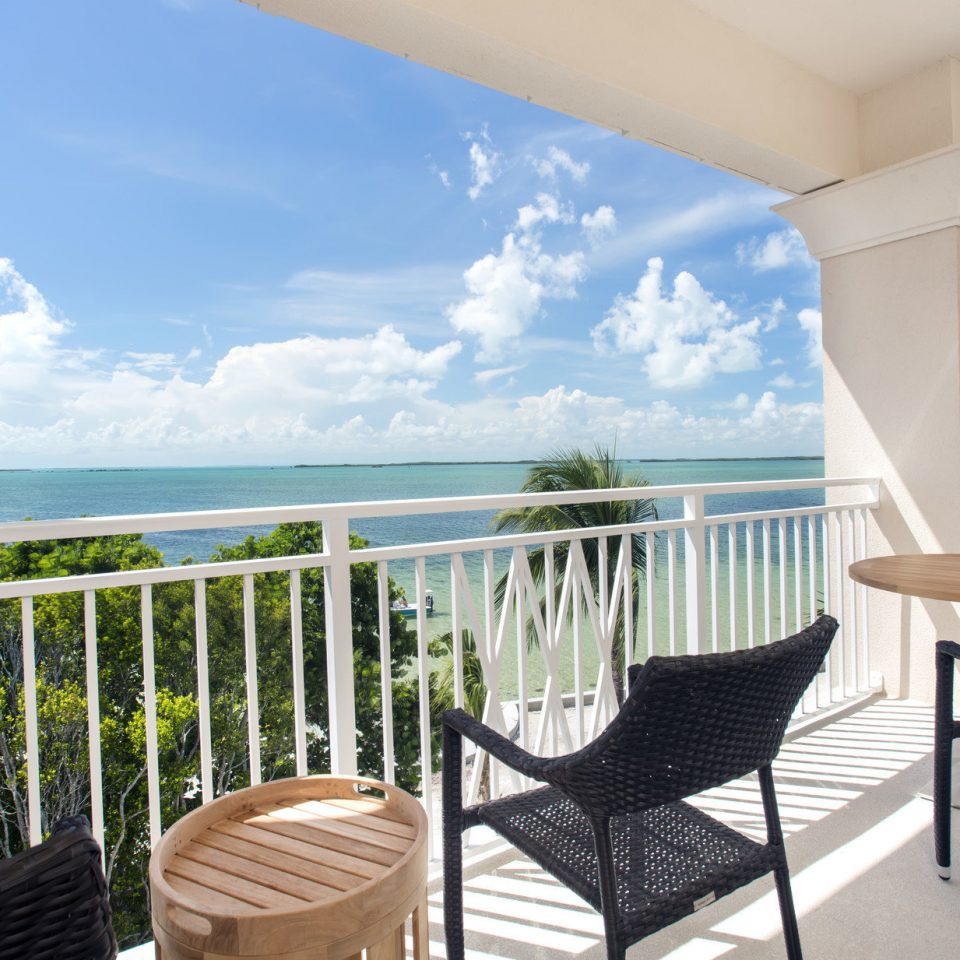 sky chair building property Deck porch Resort Villa condominium overlooking home caribbean Ocean cottage Balcony