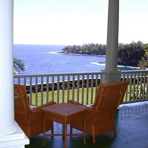 water sky chair Ocean property overlooking Villa outdoor structure Deck cottage Balcony porch shore Resort