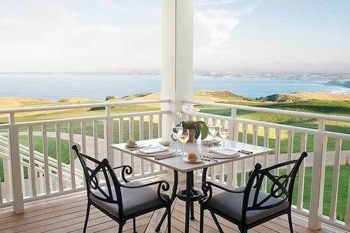 chair property Ocean porch Balcony condominium outdoor structure Villa home Deck cottage overlooking dining table