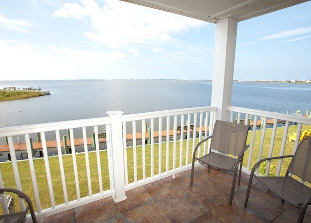 sky chair overlooking Ocean property building porch Deck Villa cottage home Balcony
