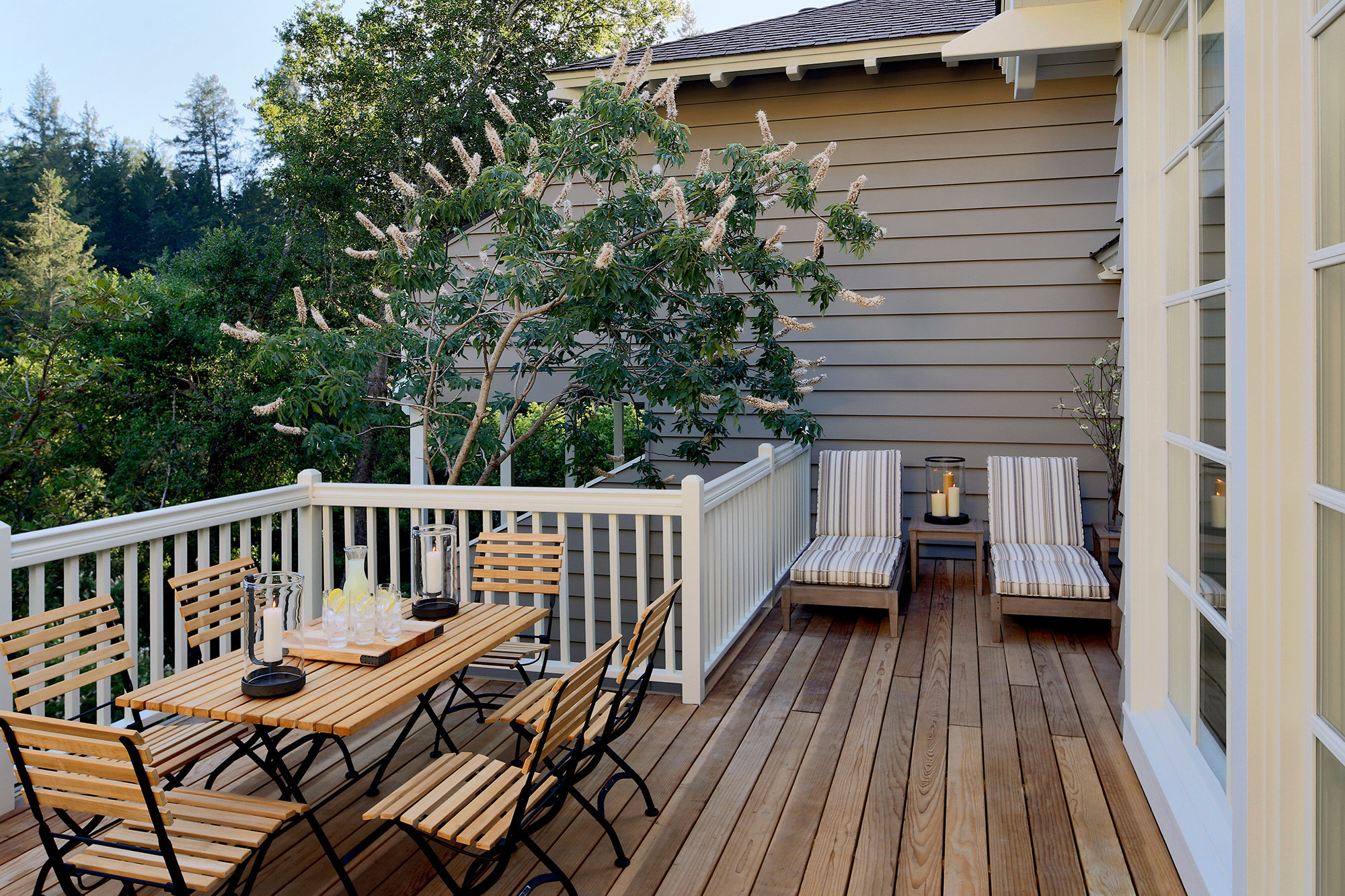 tree building chair Deck property home outdoor structure porch house Balcony backyard handrail Patio siding cottage roof yard