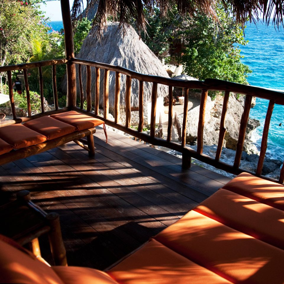 Balcony Romance Romantic Rustic Sea Tropical Waterfront tree leisure building swimming pool Resort backyard wooden Villa Deck outdoor structure porch overlooking