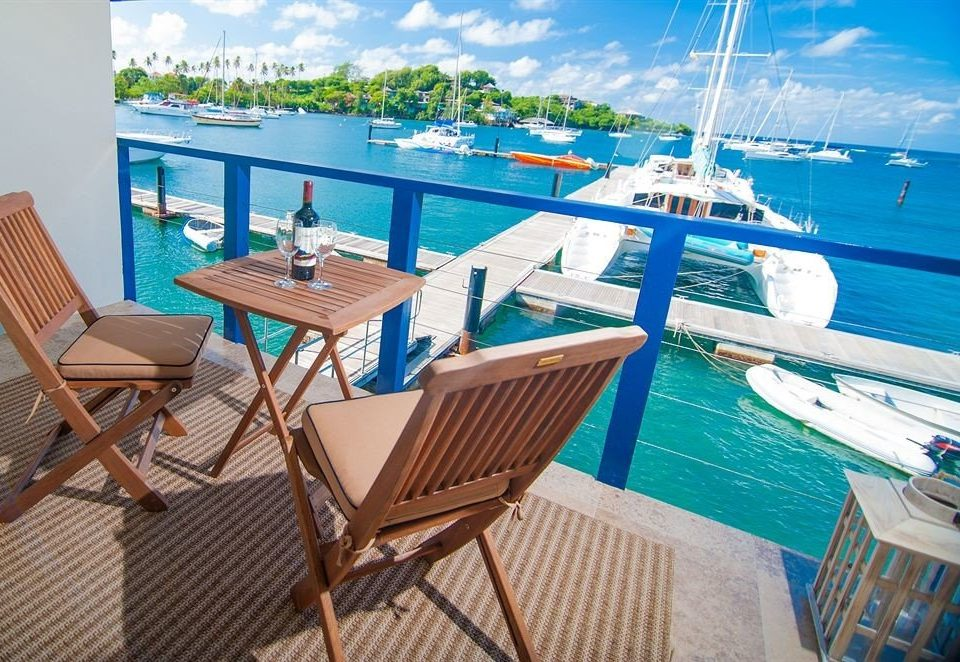 Balcony Waterfront chair property leisure caribbean wooden Resort vehicle yacht Deck set