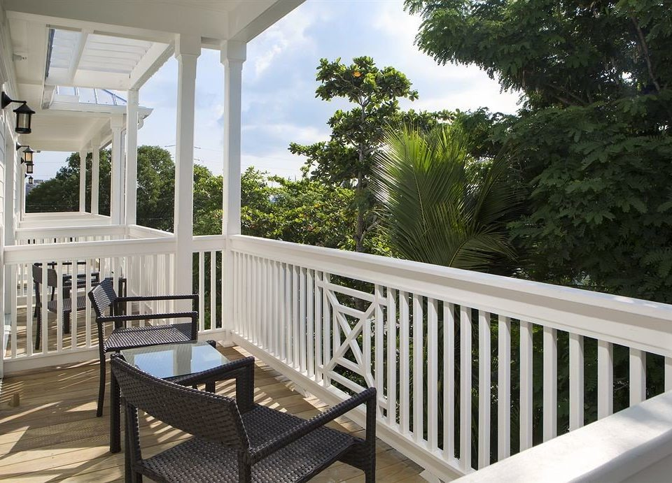 tree building porch chair property white house home Deck outdoor structure cottage Villa backyard Balcony condominium