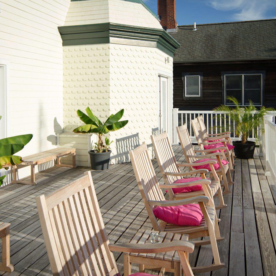 chair property building wooden porch home house cottage backyard outdoor structure Balcony Villa condominium Deck